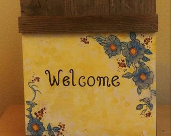 picket fence, blue flower welcome sign