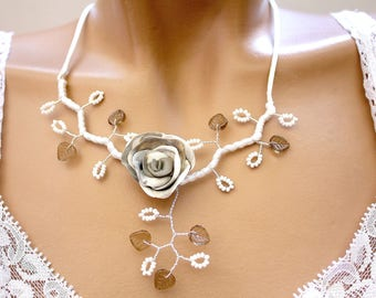 Taupe grey white floral necklace.