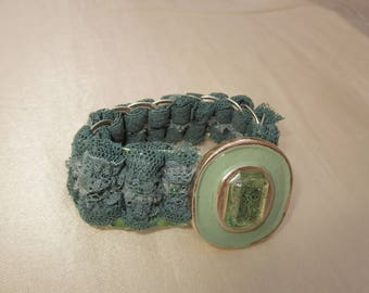 Green lace and gold tone bracelet