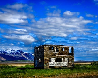 Iceland - Graffiti on an abandoned building in front of mountains