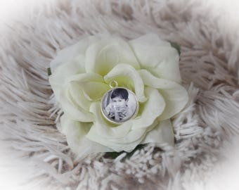 Silver round pendant with its own photo