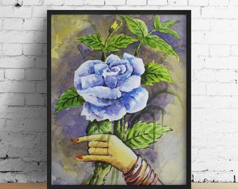 Hand holding blue flower with green leaf