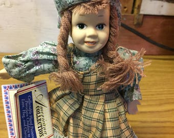 """Americana Collection Meridith 9"""" Hand Painted Porcelain Doll with Birth Certificate"""