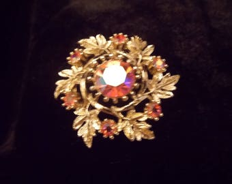 Goldtone Brooch with pink Aurora Borealis Stones