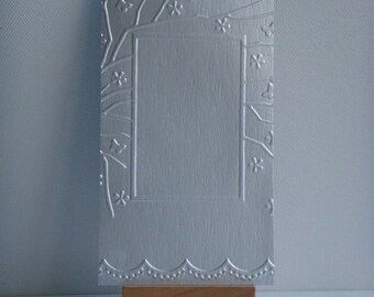 Cut 100% recycled brick embossed milk for creative photo frame