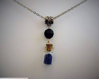 black blue bottle, with Pearl necklace.