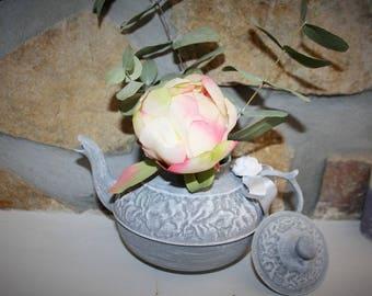 Carved metal teapot vase magazine