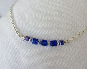 crew neck simple and elegant with bright blue glass cube beads and a silver chain - adornment