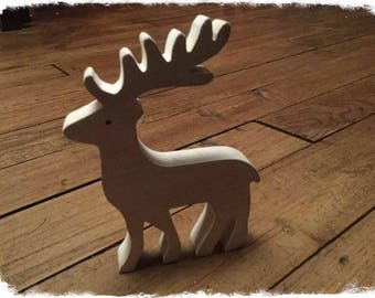 cute reindeer in wood for the tree