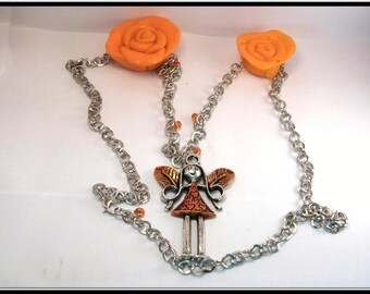Fairy pendant necklace and pink with orange polymer clay.