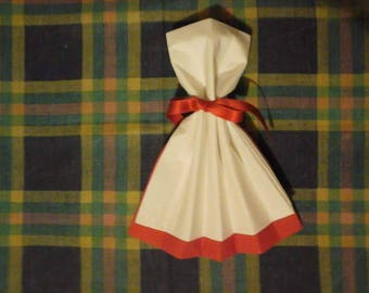 Towel folding in the shape of dress both white and red color