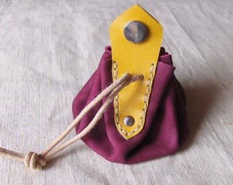 Coin purse is purple-yellow leather handmade hand sewn applique