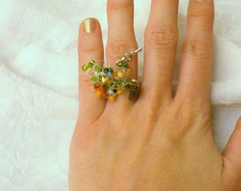 Ring fimo, crocheted, colored with ink and silver foil, Rhinestones, seed beads