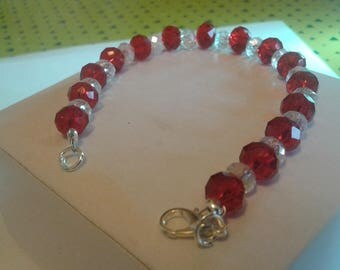 Red and transparent sfaccetate pearl bracelet