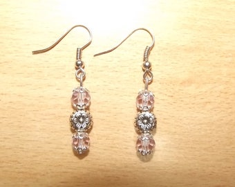 Pink earrings with charm.