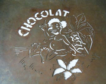 "brass stencil with inscription ""chocolate"" creative pastry"