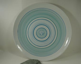 Marine atmosphere and turquoise porcelain plate