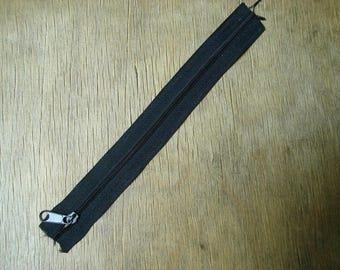 thin black plastic zipper
