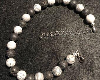 Frosted netstone and lava bead bracelet