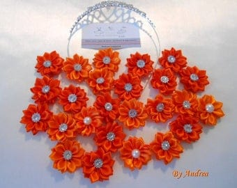 Small applique fabric flowers in orange satin with Rhinestones