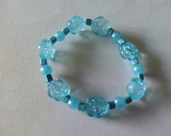 Bracelet elasticated blue flowers