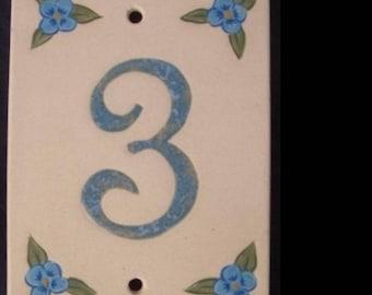 Door number, number 3, original decoration flowers linen on a beige background