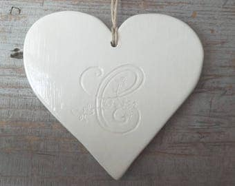 Large white heart ceramic hanging, engraved initial ' it
