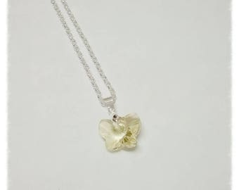 With a golden Swarovski Crystal Butterfly pendant