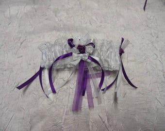 White, purple and white bridal garter