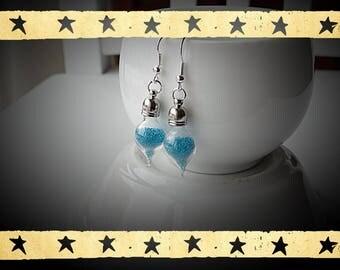 globe-shaped blue microbead filled glass mounted on earrings