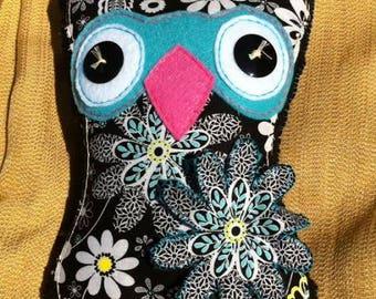 Large black fabric and felt owl plush