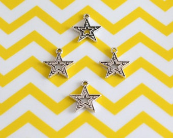 Set of 4 17 mm star charms, antique silver