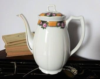 Théière / cafetière en porcelaine de Limoges signée Balleroy à motif floral et couleurs originales