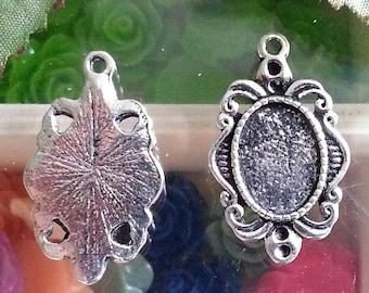 top: 10 x 14 mm medium cabochon antique silver. 30 x 18 x 2 mm, hole: 2 mm