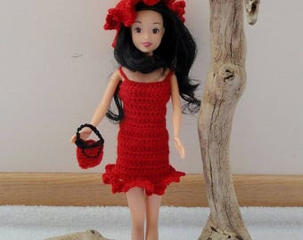 Little red dress for Barbie doll with her hat and purse.