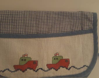 Blue bib and small boats