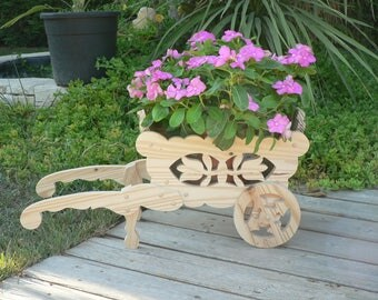 Small wheelbarrow wood cut for decoration
