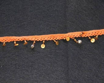 Beaded orange cotton crochet lace and Bell