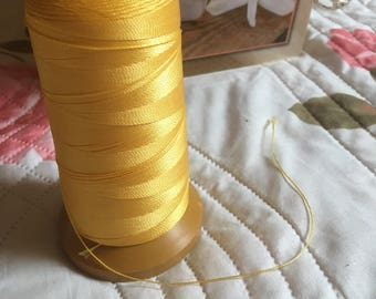 Yellow macrame cord or wire. 0.5 mm.
