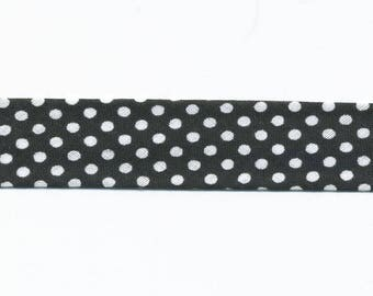 Black bias with white polka dots by the yard