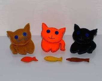 Three kittens and their fish made of felt