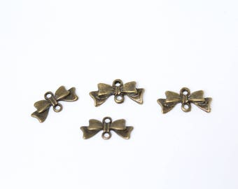 Spacer antique bronze color in the shape of bows