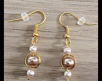 Earrings with glass beads beige gold and cream.