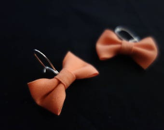 Salmon color fabric bow earrings
