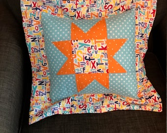Orange and teal pillow