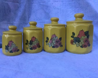 Vintage yellow metal canisters - set of 4