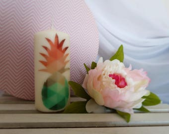 Trendy colorful green and pink pineapple candle