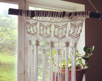 This is a hand made Macrame wall hanging