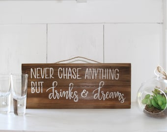 Never Chase Anything But Drinks and Dreams Sign