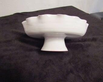 Terracotta glazed white fruit bowl.